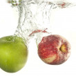 Apple fruit drop in water — Stock Photo