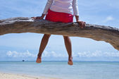Woman relaxing in the beach — Stock Photo
