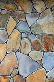 Fragmento de uma parede de pedra lascada — Foto Stock