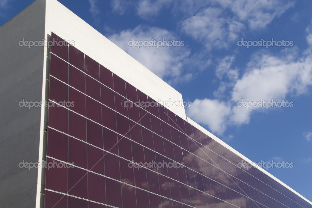 A building with hundreds of solar panels on the facade — Stock Photo #11077931