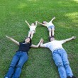 Asian family lying on the grass — 图库照片