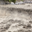 Stock Photo: River in flooding after heavy rains