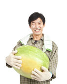 Happy middle aged asian farmer holding big watermelon — Stock Photo