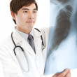 Royalty-Free Stock Photo: Young doctor with xray