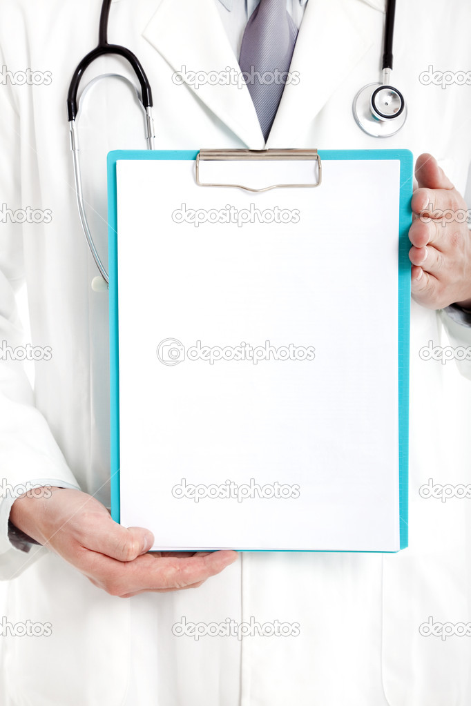 Doctor holding blank clipboard  Stock Photo #11255561