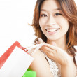 Happy asian woman with shopping bag — Stock Photo