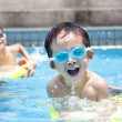 Asian boy in swimming pool — Stock Photo