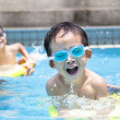 Asian boy in swimming pool — Stock Photo #11600339