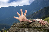 Hand for help on the mountain — Stock Photo