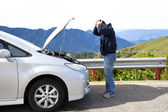 Angry man with breakdown car on the country road — Stock Photo