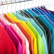 Variety of casual shirts on hangers - Stok fotoğraf