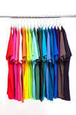 Colorful t-shirt with hangers isolated on white — Stock Photo