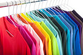 Variety of casual shirts on hangers — Stok fotoğraf