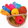 Colored threads for needlework in the basket — Stock Photo #11395578