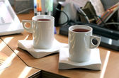 Photo of a tea mug with black tea at office — Stock Photo