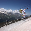 Skiing and ski lift on mountain — Stock Photo