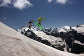 Skiers in mountains — Stock Photo