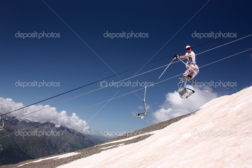 Skiing and ski lift on mountain  Stock Photo #11246813