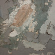 Stock Photo: Background of grey, peeling paint on an old wall