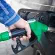 Stock Photo: Hand Refilling black Car with Fuel