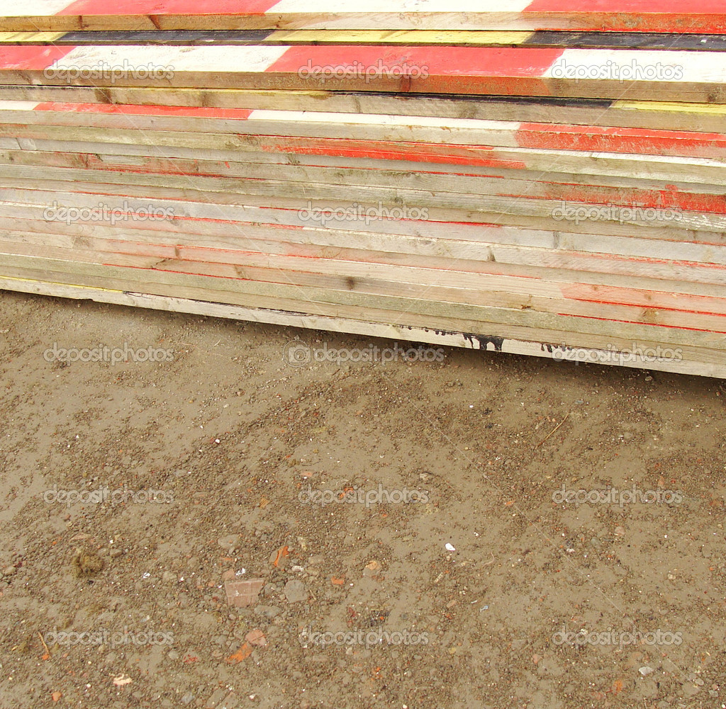 Pile stack of colored timber on a construction site — Stock Photo #10955173