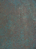 Grunge worn blue metal surface with a pattern — Stock Photo