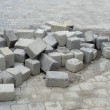 Stack of cubic tile laying on pavement — Foto de stock #11339005