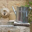 Watering can on washhouse. — Stock Photo