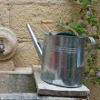 Watering can on washhouse. - Stock Photo