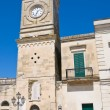 Clocktower. Castrignano de' Greci. Puglia. Italy. - Photo