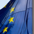 European Union Flag Waves in Cloudy Sky — Stock Photo #11142291