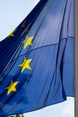 European Union Flag Waves in Cloudy Sky — Stock Photo