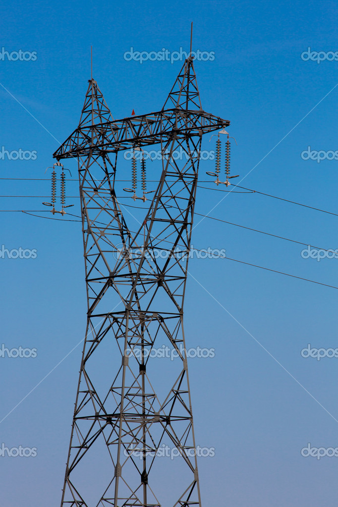 Electricity pylon with blue sky and sun — Stock Photo #11150103