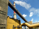 Electrostatic precipitator and a smoking chimney red white — Stock Photo