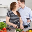 Stock Photo: Happy couple making a salad