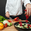 Stock Photo: Chef adding ingredients