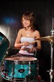 Happy female drummer — Stock Photo