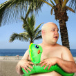 Fat man on the beach — Stock Photo
