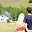 Young couple and a house — Stock Photo