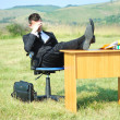 Business man at desk outside — Stock Photo