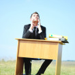 Business man at desk outside — Stock Photo #11697333