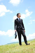 Business man walking — Stock Photo