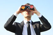 Business man with binoculars — Stok fotoğraf