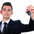 Business man with car keys — Stock Photo