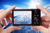 Taking photo of a skier — Stock Photo