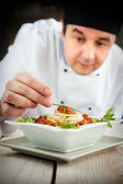Male chef in restaurant — Stock Photo