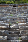 Ancient stone staircase of the theater, leading up — Stock Photo