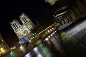 Paris docks with Notre-Dame cathedral — Stock Photo