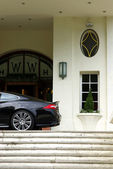Sport car in front of a fancy hotel — Stock Photo
