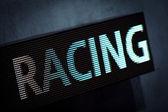 二极管显示和赛车的刻字 — 图库照片